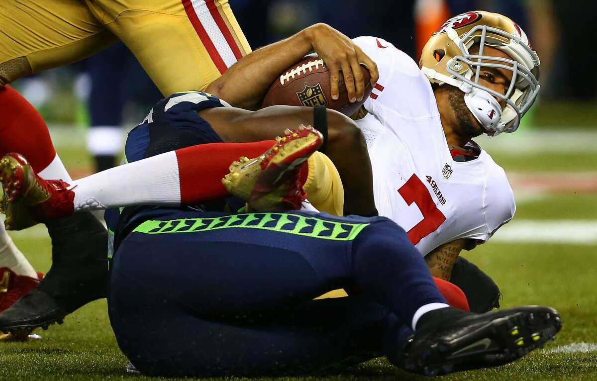 San Francisco 49ers quarterback Colin Kaepernick is sacked in the second half by the Seattle Seahawks. Photographed on Sunday, September 15, 2013 at CenturyLink Field in Seattle. (Joshua Trujillo, seattlepi.com)