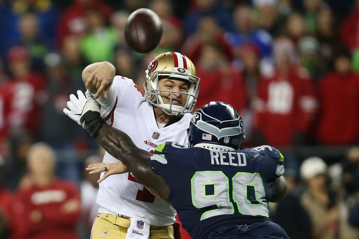 Seahawks defensive lineman Jarran Reed gets to 49ers quarterback Nick Mullens just after the pass during the second half of Seattle's game against San Francisco, Sunday, Dec. 2, 2018 at CenturyLink Field. (Genna Martin, seattlepi.com)
