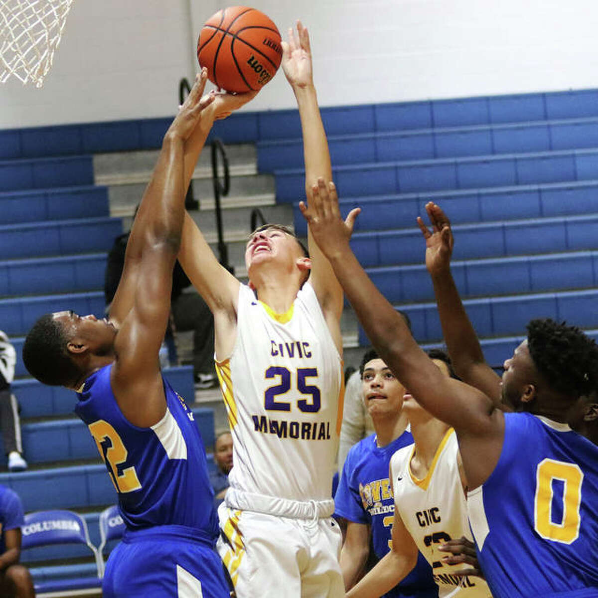 CM's 6-foot-7 freshman Sam Buckley (25) shoots over Lovejoy's D'Andre Loston in the first half Thursday at the Columbia Tournament.