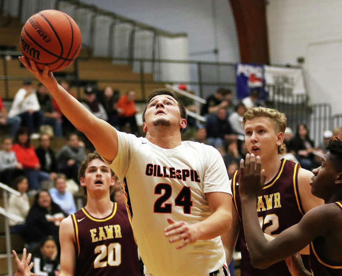 Gillespie's Anthony Kravanya (24) gets past EA-WR defenders Jake Wells (20), Carson Reef (22) and Antonio Hardin to score in the first half Thursday at the 54th annual Carlinville Holiday Tournament. Kravanya score 15 points in the Miners win to go past 1,000 for his career.