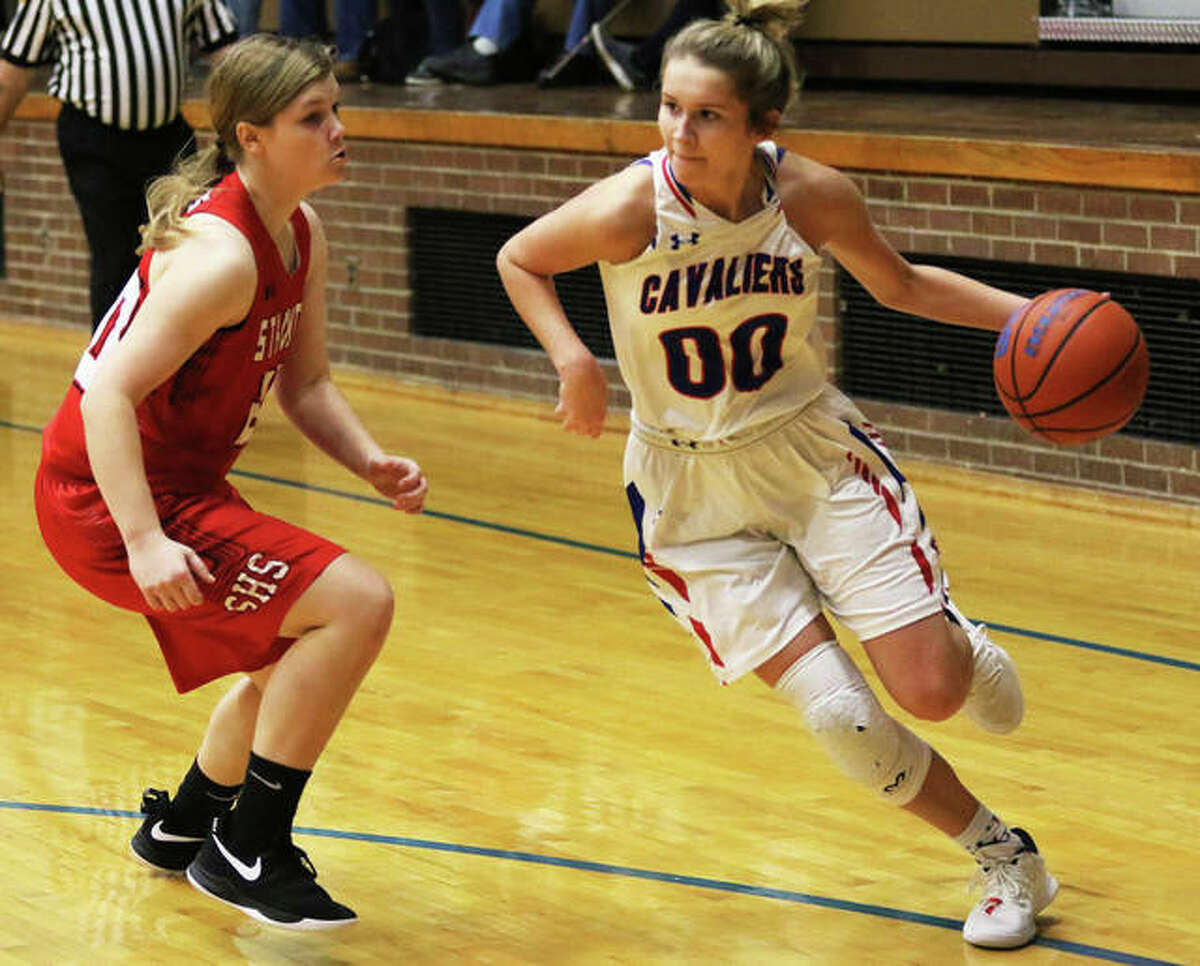 Carlinville's Corin Stewart (00) drives on Staunton's Brigitte Long on Thursday night at the Carlinville Tournament.