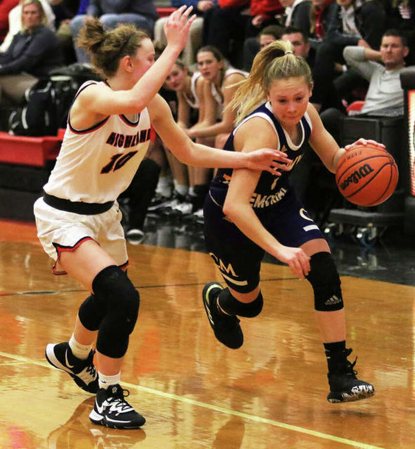 CM's Tori Standefer (right) drives on Highland's Kirsten Taylor during a Dec. 18 game in Highland. On Thursday at the State Farm Classic in Bloomington, Standefer matched her career high with 15 points in the unbeaten Eagles win over Normal West. Photo: Greg Shashack | The Telegraph