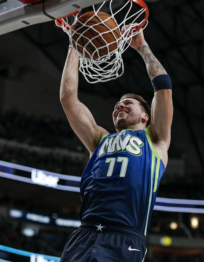 The Mavericks' Luka Doncic dunks in a win over the Spurs. Doncic scored 24 points, adding 10 rebounds and eight assists. Photo: Brandon Wade / Associated Press