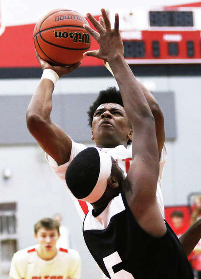 Alton's Moory Woods, shown taking a shot in the lane against Carnahan last month at the Alton Tourney, led the Redbirds with 27 points Thursday in a first-round win at the Centralia Tourney. Photo: Greg Shashack | The Telegraph