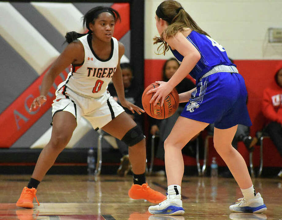 Edwardsville's Quierra Love, guards Westminster's Brooke Highmark in the first quarter on Thursday at the Visitation Christmas Tournament. Photo: Matt Kamp|The Intelligencer