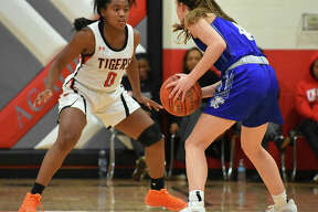 Edwardsville's Quierra Love, guards Westminster's Brooke Highmark in the first quarter on Thursday at the Visitation Christmas Tournament.