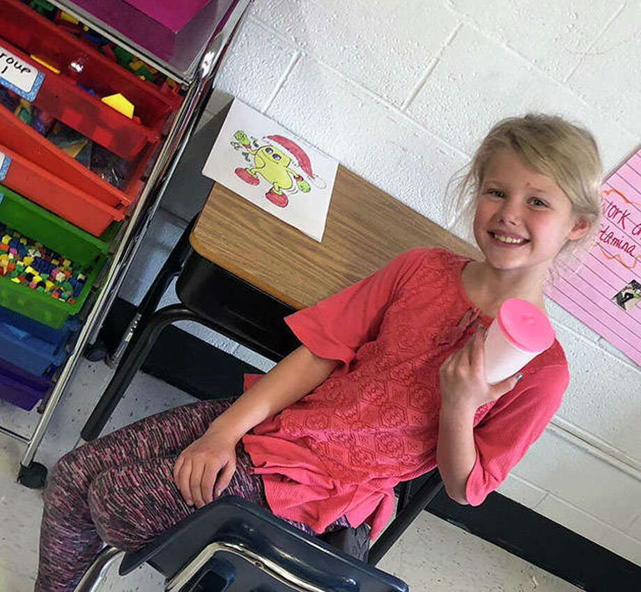 Winchester Elementary School student Bella Jones made a soybean drum and a coloring page with Fred the Dancing Christmas Soybean. Photo: Photo Provided
