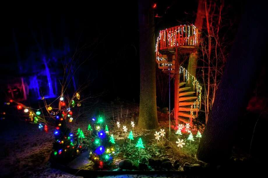 The home and front yard of Jeff and Sherry Rogers is illuminated by a spectacular lights display Friday, Dec. 20, 2019. (Katy Kildee/kkildee@mdn.net)