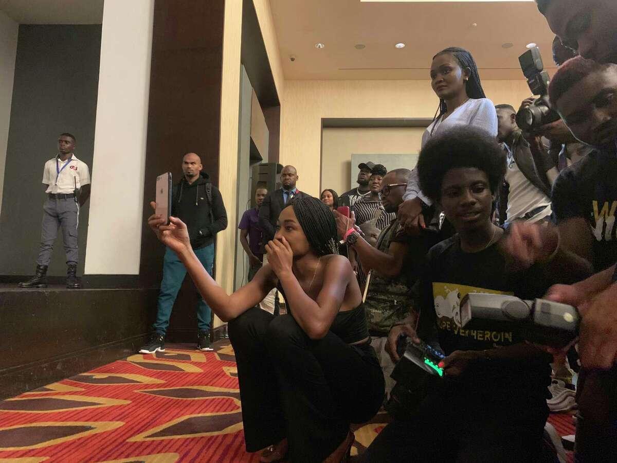 Fans watch Cardi B talk Dec. 8, 2019, at the Kempinski Hotel in Accra.
