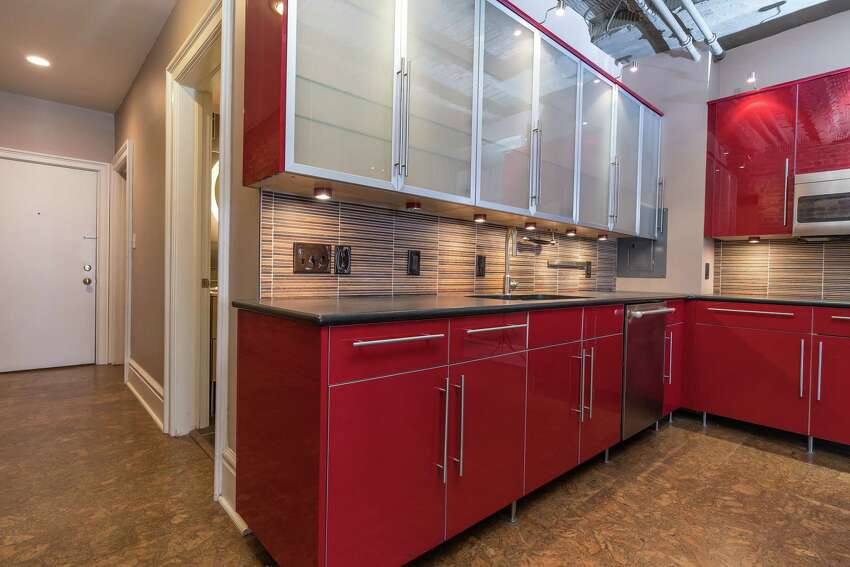 Glossy red cabinets inside of 352 State St., Unit 6A, Albany, HOTW on Jan. 13, 2019.