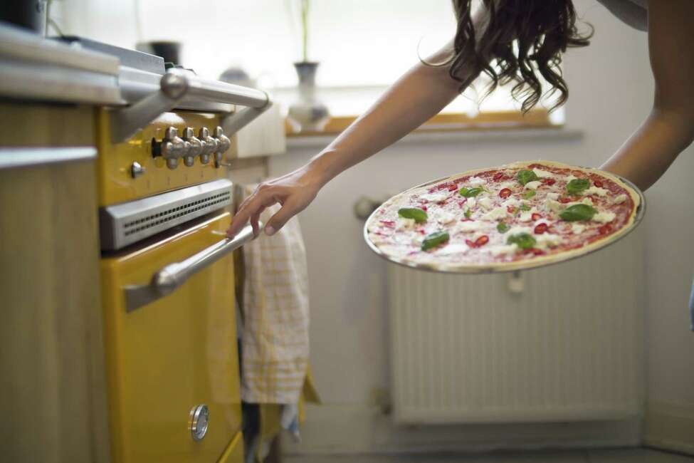 Save the pizza-delivery person one more stop by making pizza at home. (Getty Images)