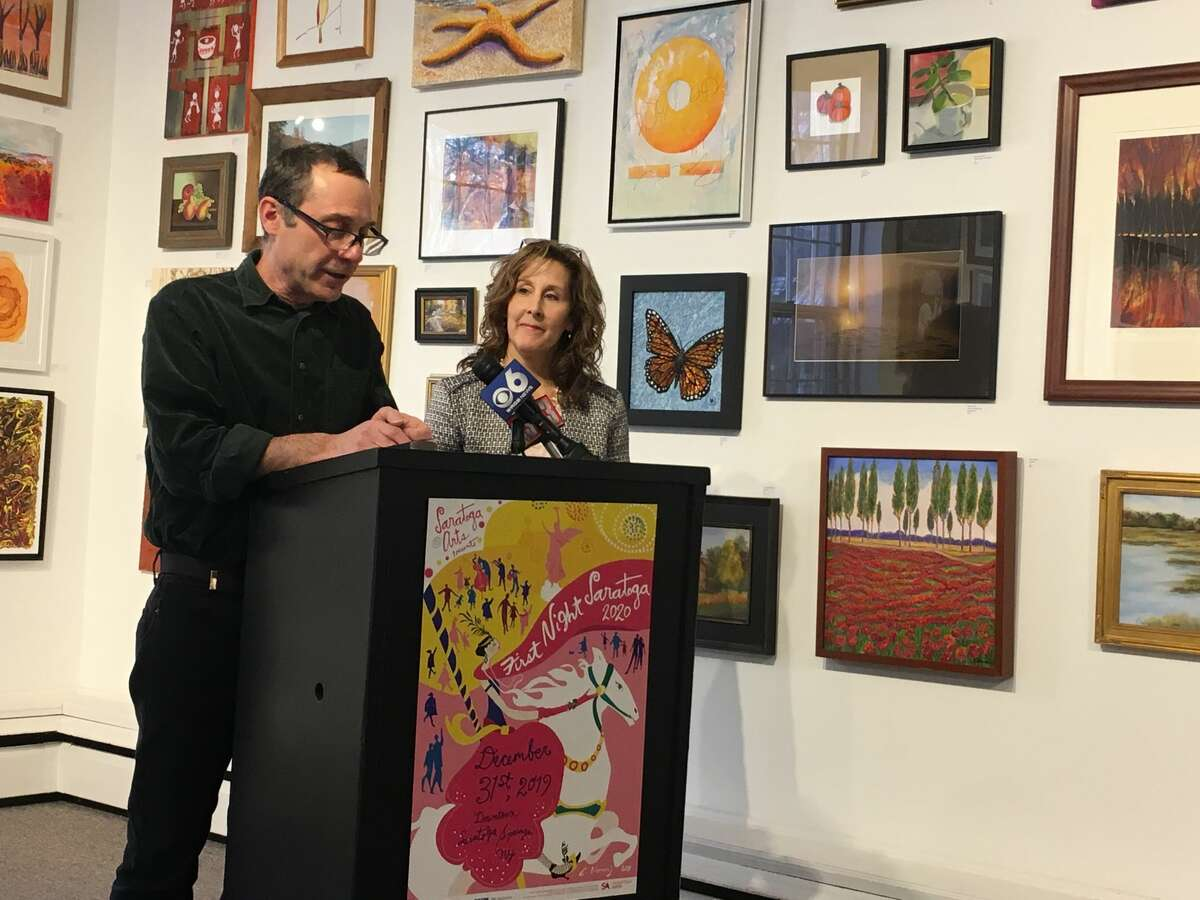 Joel Reed, executive director of Saratoga Arts, and Susanne Simpson, president of the board at Saratoga Arts, announce that the funding for the fireworks has been found on Dec. 26, 2019 at Saratoga Arts on Broadway in Saratoga Springs.