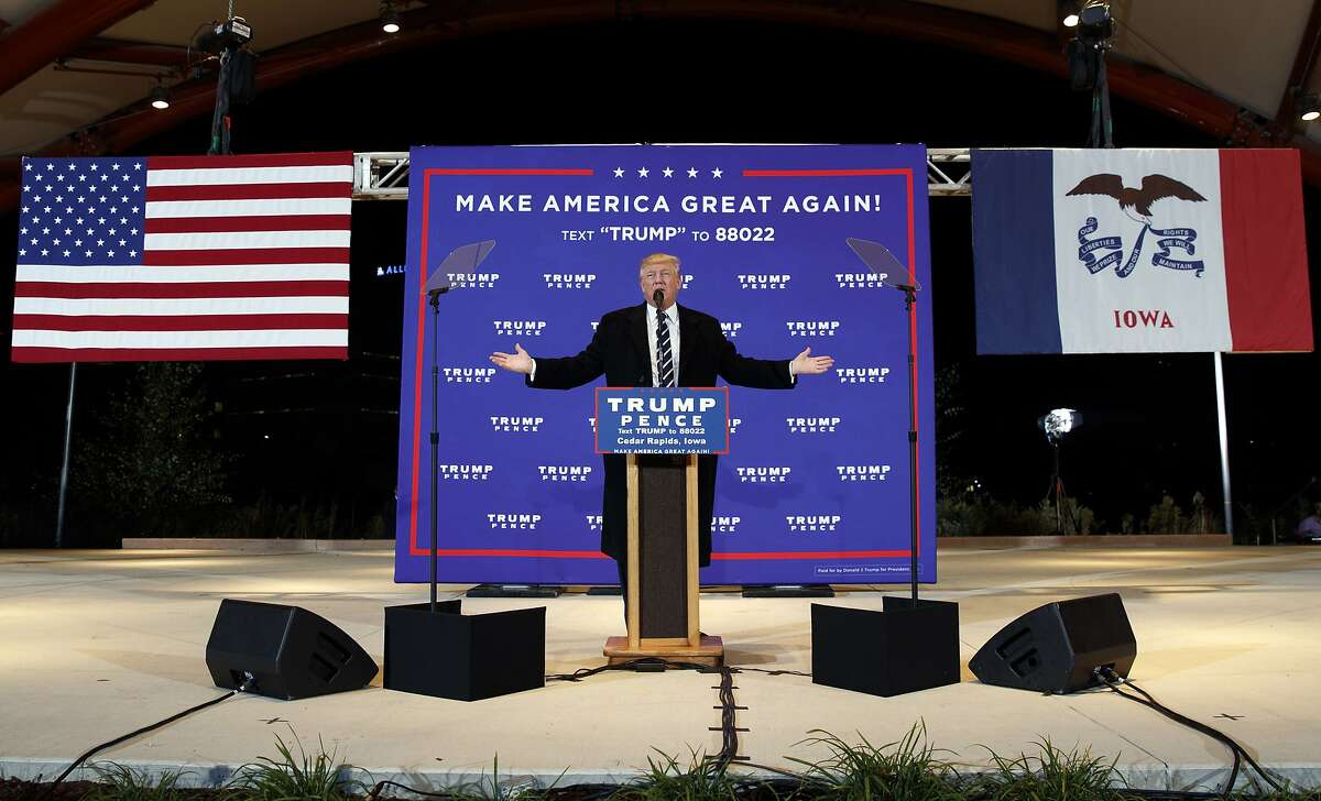 FILE - In this Oct. 28, 2016, file photo, then-Republican presidential candidate Donald Trump speaks during a campaign rally in Cedar Rapids, Iowa. Few states have changed politically with the head-snapping speed of Iowa. (AP Photo/ Evan Vucci, File)