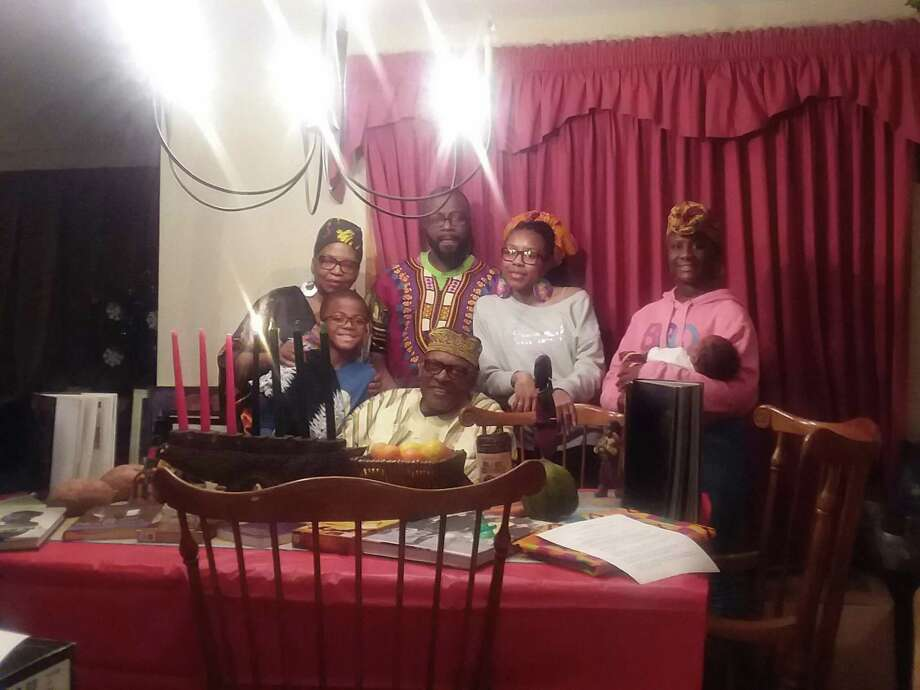 Our Culture is Beautiful in Torrington marks the holiday of Kwanzaa this week. Angaza and Effie Mwando of Torrington, shown here with their family members, are the founders of Our Culture is Beautiful. Photo: Our Culture Is Beautiful / Contributed Photo /
