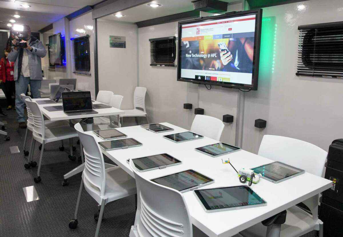 The Houston Public Library's new Mobile Express, a technology lab and library van, can seat 24 people in a class. The van will help the Houston Public Library make up for the continuing closures of some of its branches due to damage from Hurricane Harvey. Photo taken inside the van at Barbara Bush Literacy Plaza on Tuesday, Dec. 10, 2019, in Houston.