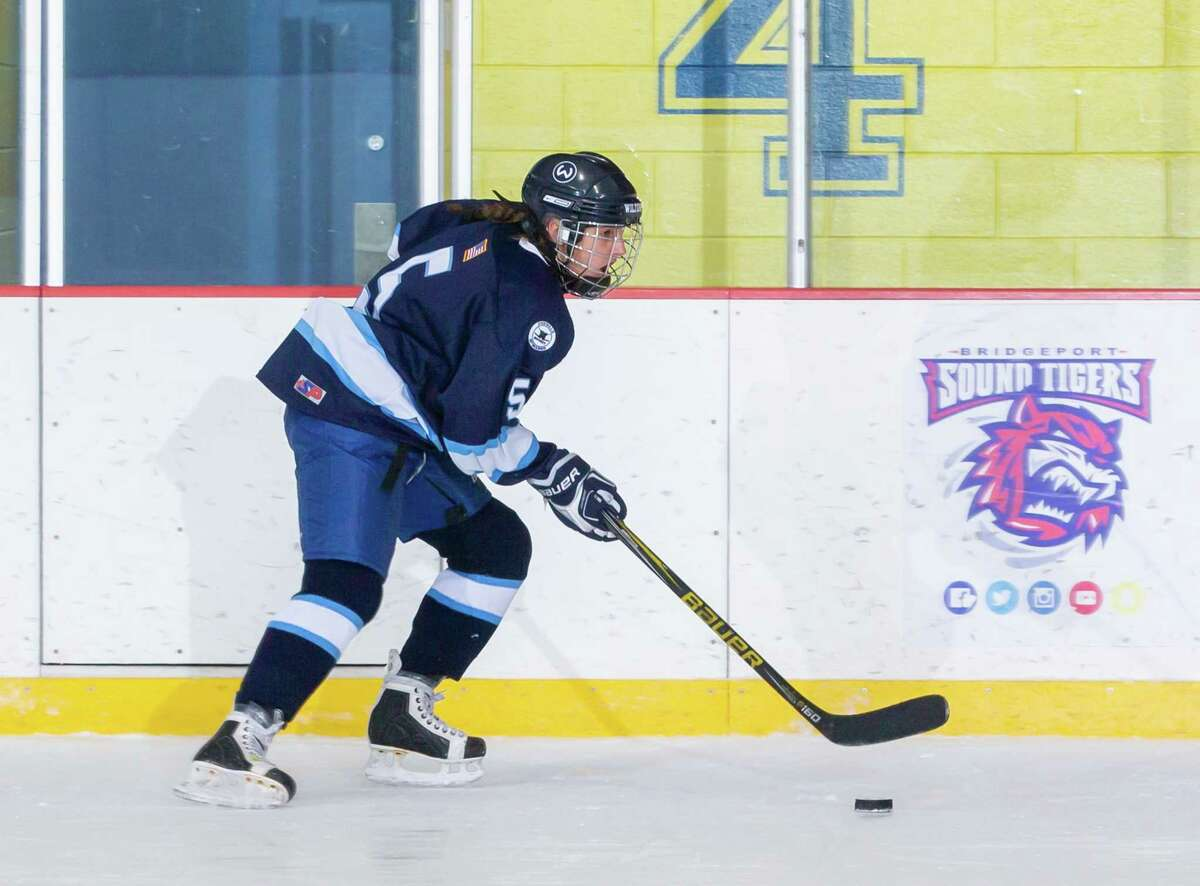Caitlyn Hocker had four points as the Wilton-Norwalk-McMahon girls hockey team got its first win of the season on Saturday.