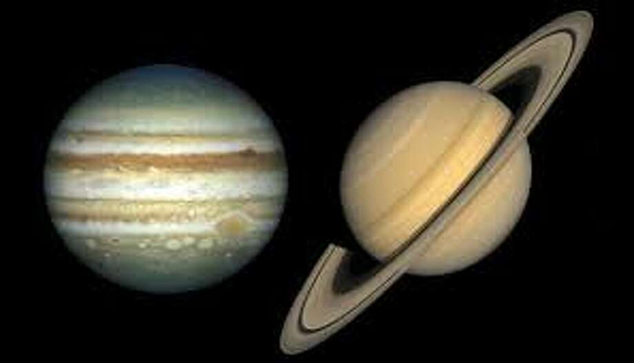 Jupiter and Saturn took center stage across the night sky last night as they formed a triangle with the waning, gibbous moon-meaning they shared the same celestial longitude, said space.com. Photo: NASA.GOV