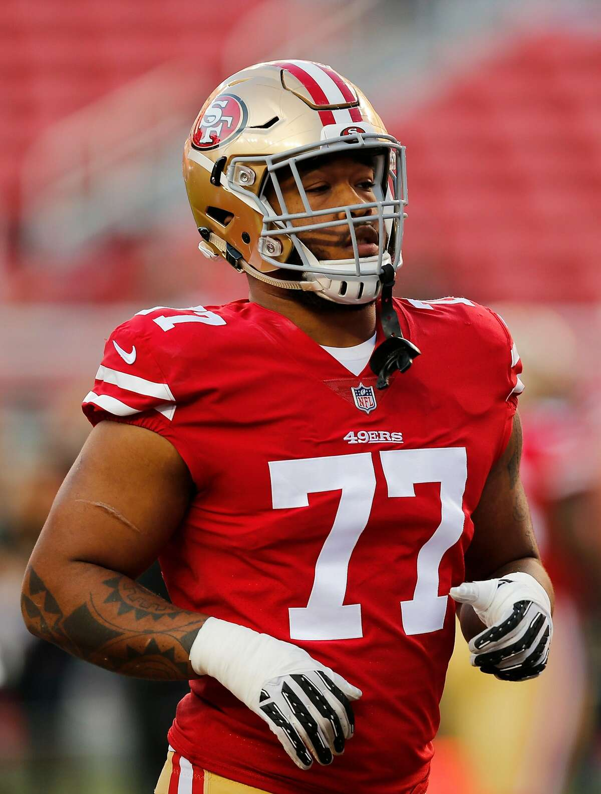 San Francisco 49ers defensive tackle Jullian Taylor (77) practices before an NFL preseason game against the Los Angeles Chargers at Levi's Stadium on Thursday, Aug. 30, 2018, in Santa Clara, Calif.