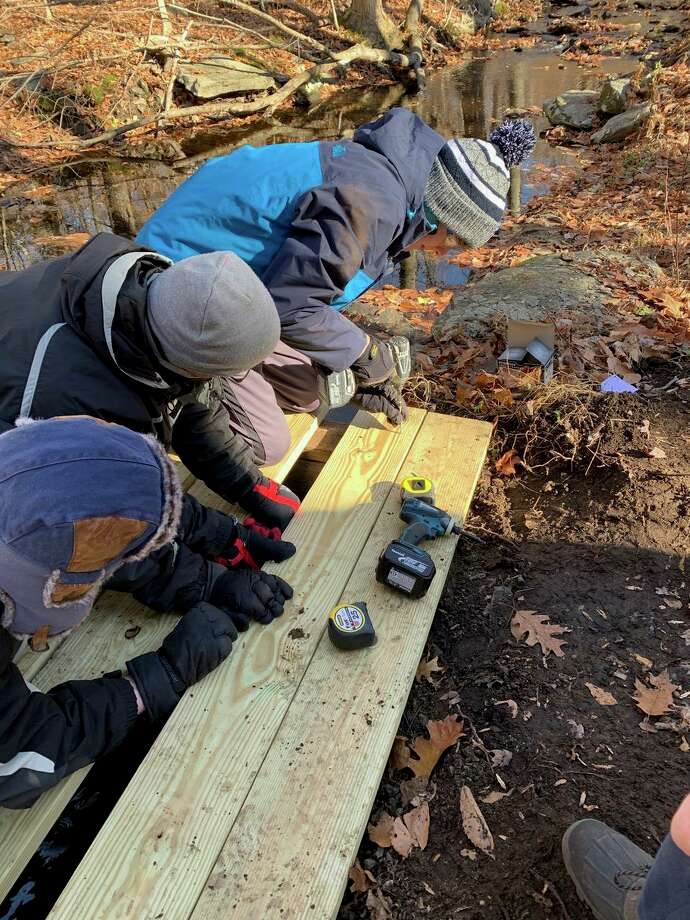 Scouts work on the bridge deck. Photo: Contributed Photo