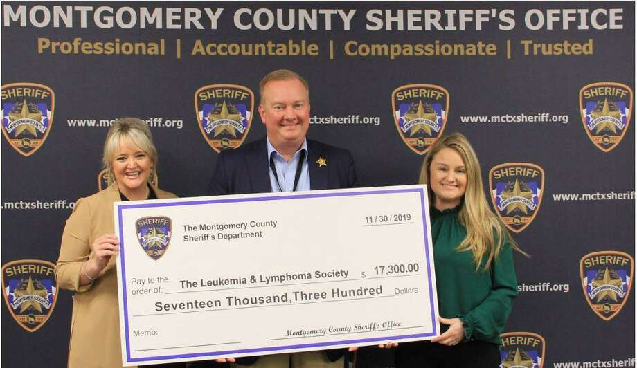 Sheriff Rand Henderson is seen Dec. 16 at the Montgomery County Sheriff's Office with a check for The Lymphoma and Leukemia Society. Photo: Courtesy Of The Montgomery County Sheriff's Office