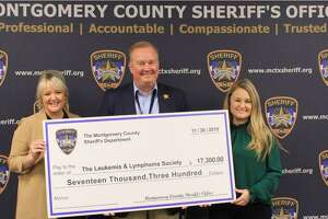 Sheriff Rand Henderson is seen Dec. 16 at the Montgomery County Sheriff's Office with a check for The Lymphoma and Leukemia Society.