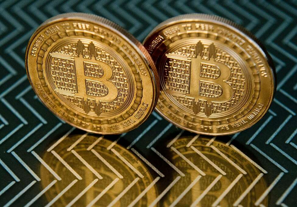 (FILES) In this file photo taken on June 17, 2014 in Washington, DC shows bitcoin medals. (Photo by KAREN BLEIER / AFP) (Photo by KAREN BLEIER/AFP via Getty Images)
