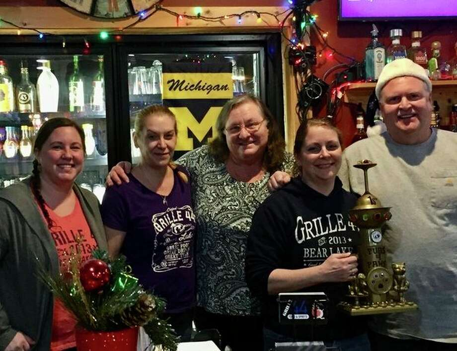 "Grille 44 in Bear Lake won first place in Homeward Bound Animal Shelter's annual Pubs for Paws fundraiser by selling ""paws"" throughout November. Pictured are servers Jenny and Monica, Mary Tebbenhoff (Manistee County Humane Society board member), bartender Melanie W. and Kevin Buckner (owner of Grille 44). (Courtesy photo)"