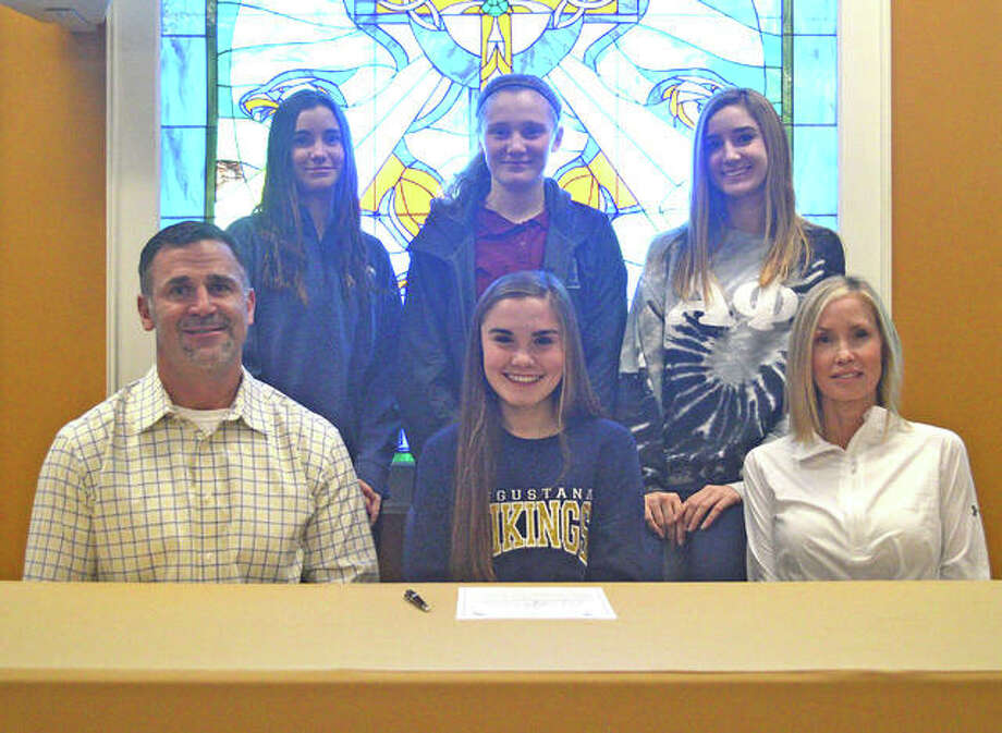 Father McGivney senior Jayde Speight, front row center, is joined by her family as she commits to play soccer at Augustana College in Rock Island.