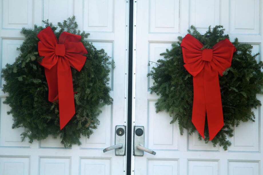 Holiday wreaths with red bows decorate the doors to Westport's Town Hall on Christmas Eve 2019. Photo: DJ Simmons /Hearst Connecticut Media /