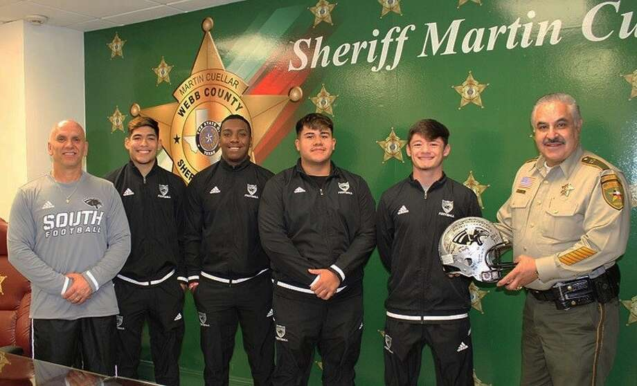 Coach Joe Coss and captains from the United South High School varsity football team visited Webb County Sheriff headquarters to present Sheriff Martin Cuellar with a football helmet signed by all of the players last week. Photo: Courtesy