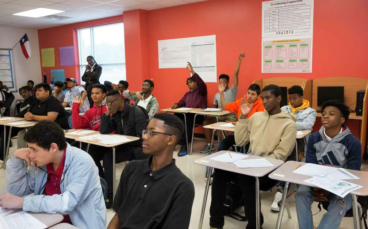 A group of Miles Ahead Scholars students participate in learning to understand identity in an English class at Worthing High School on Tuesday, Oct. 29, 2019, in Houston. The program, which was piloted by state Sen. Borris Miles at the urging of Lt. Gov. Dan Patrick, identifies high-potential freshmen and sophomore male students at three HISD high school and aims to get them enrolled in the nation's most prestigious universities.