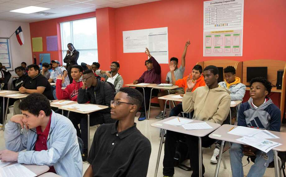 A group of Miles Ahead Scholars students participate in learning to understand identity in an English class at Worthing High School on Tuesday, Oct. 29, 2019, in Houston. The program, which was piloted by state Sen. Borris Miles at the urging of Lt. Gov. Dan Patrick, identifies high-potential freshmen and sophomore male students at three HISD high school and aims to get them enrolled in the nation's most prestigious universities. Photo: Yi-Chin Lee, Houston Chronicle / Staff Photographer / © 2019 Houston Chronicle