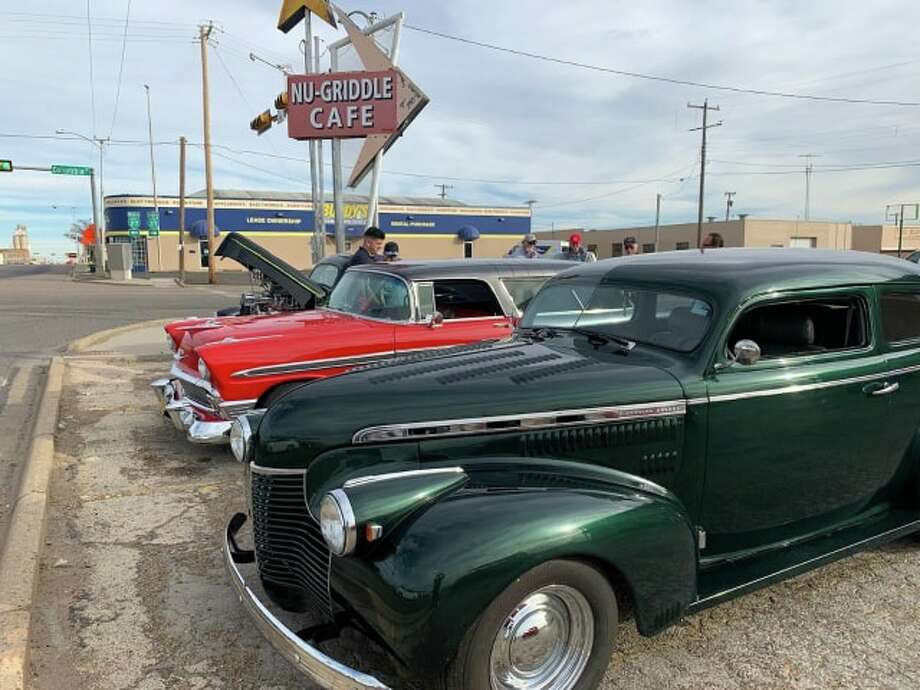 Antique cars were on display at the Nu-Griddle Café Tuesday as part of a revived tradition to host an antique car show at the restaurant on Christmas Eve. Photo: Don Brown/For The Herald