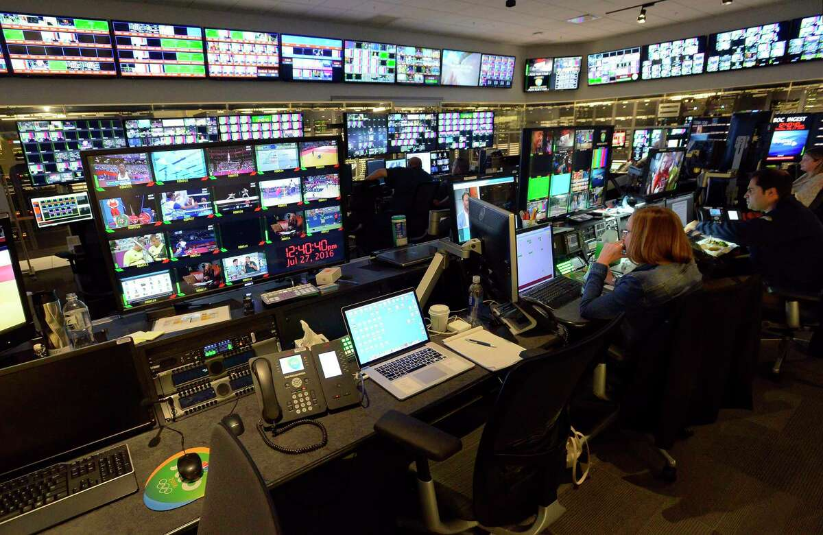 Hundreds of broadcast feeds are monitored in the Broadcast Operations Center at NBC Sports Center studios and broadcast operations in Stamford, Conn., on July 27, 2016. The Stamford campus has served as NBC Sports' U.S. production base for the past three Olympics.