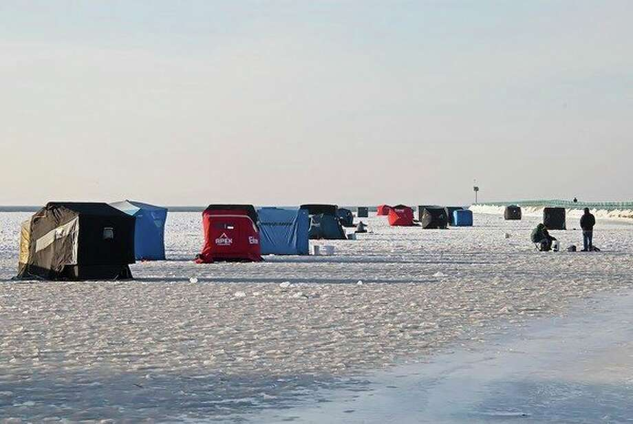 The mouth of the Pigeon River, at Pointe Park in Caseville recently became an impromptu shanty town recently before the weather warmed up, as fishermen took to the ice hoping to catch Walleye and Lake Trout. (Bill Diller/For the Tribune)