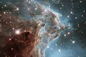 This image released on March 17, 2014 by the ESA and taken by the NASA/ESA Hubble Space Telescope shows the Monkey Head Nebula or NGC2174, to celebrates its 24th year in orbit. NGC 2174 lies about 6,400 light-years away in the constellation of Orion (The Hunter). Hubble previously viewed this part of the sky back in 2011 the colorful region is filled with young stars embedded within bright wisps of cosmic gas and dust. This portion of the Monkey Head Nebula was imaged in the infrared using Hubble's Wide Field Camera 3.