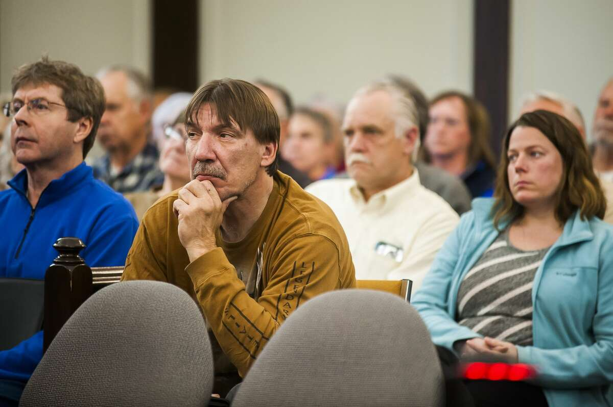 Members of the public listen to Midland County Circuit Court Judge Stephen P. Carras during a public court hearing on Friday, May 3, 2019 regarding petitions filed jointly by Midland and Gladwin Counties to formalize the normal summer and winter lake levels for Sanford Lake, Wixom Lake, Smallwood Lake and Secord Lake as well as to establish and approve the boundaries of a special assessment district of property owners affected by the lakes. (Katy Kildee/kkildee@mdn.net)