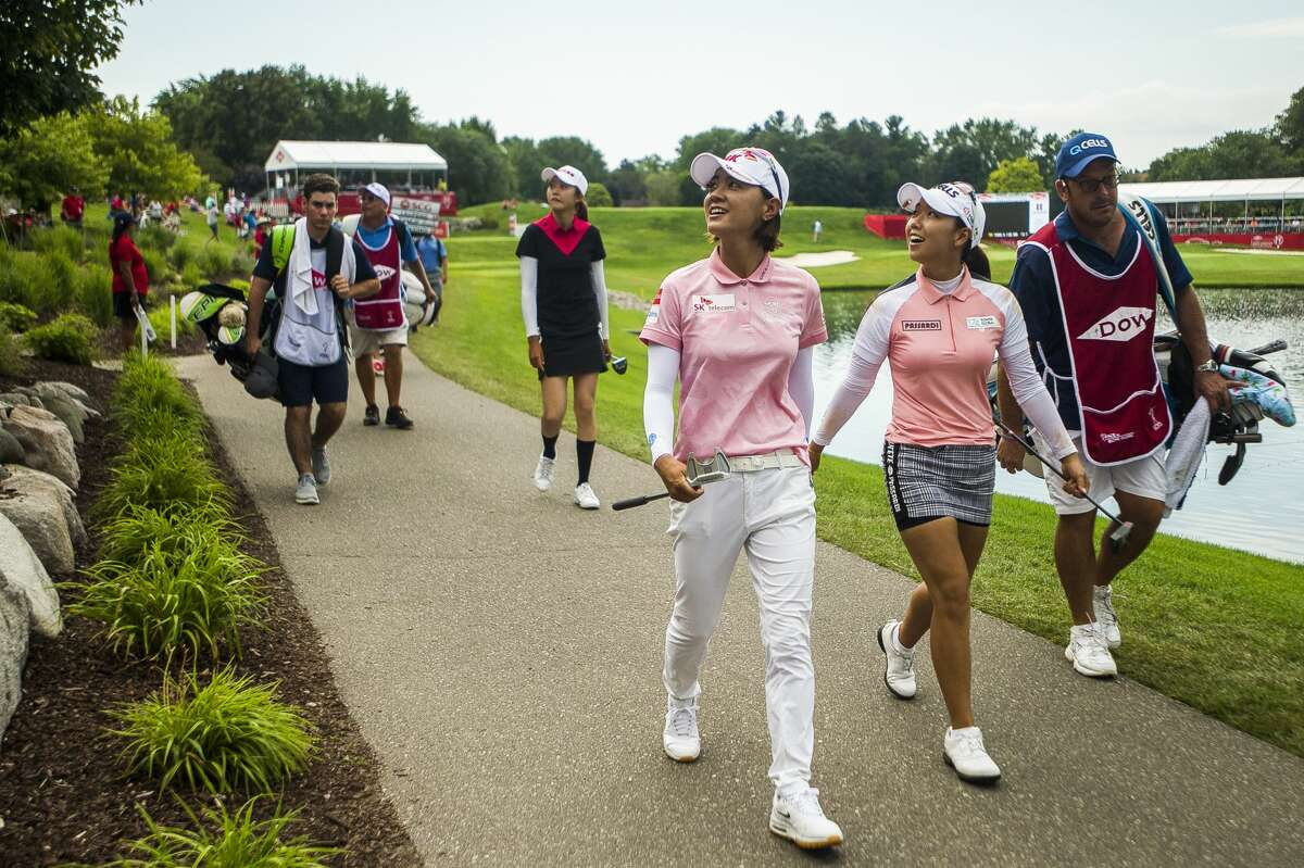 Na Yeon Choi of Korea, left, and her playing partner Jenny Shin of Korea compete the fourth and final round of the Dow Great Lakes Bay Invitational on Saturday, July 20, 2019 at Midland Country Club. (Katy Kildee/kkildee@mdn.net)