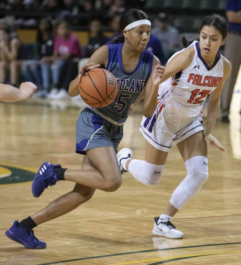 Midland High's Makayla Williams drives the lane around El Paso Eastlake's Kayla Quintana 12/27/19 during a match at the 2019 Byron Johnston Holiday Classic at the Chaparral Center. Tim Fischer/Reporter-Telegram Photo: Tim Fischer/Midland Reporter-Telegram