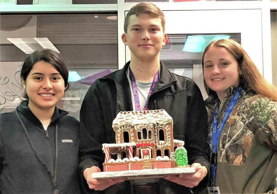 Winners of the gingerbread house decorating contest for restaurant management students at Needville High School are, from left, the team of Adriana Arredondo, Cade Hurta, Chyanne Johnson. Photo: Needville High School / Needville High School