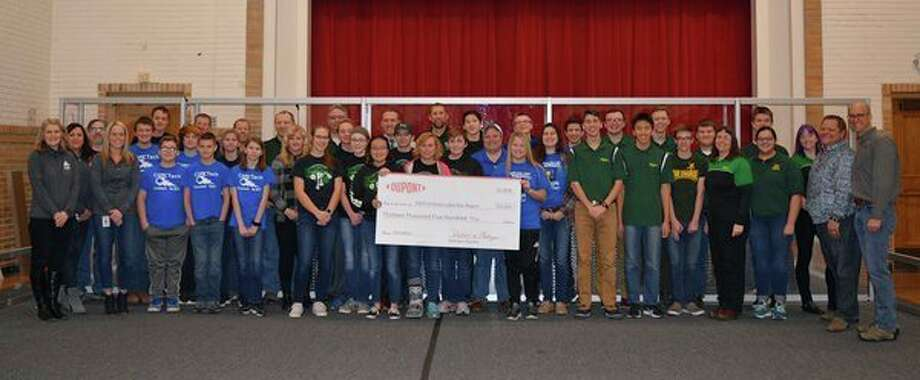 Local leaders at DuPont in Michigan presented $13,500 to FIRST Robotics Competition teams in the Great Lakes Bay Region. FIRST is a non-profit organization that inspires innovative students to be science and technology leaders. (Photo provided/DuPont)