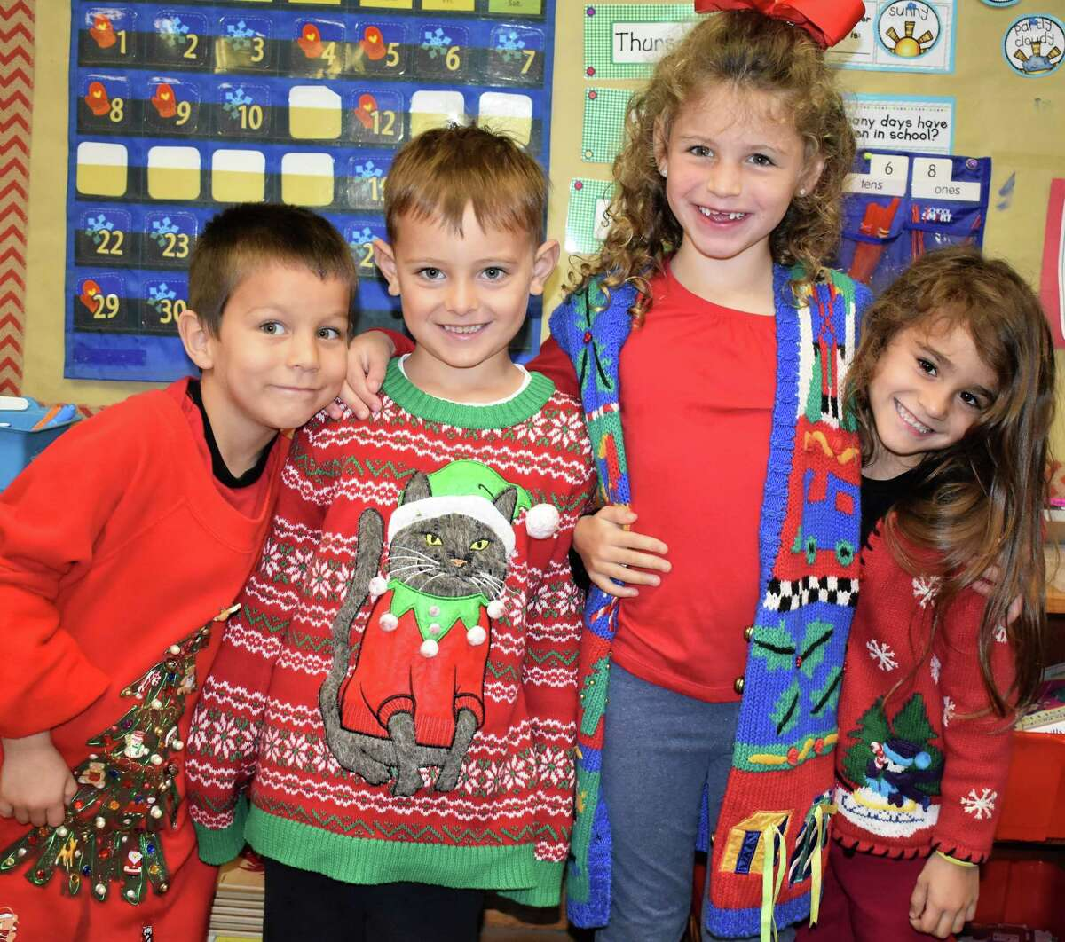 Students at Needville Elementary celebrated Ugly Sweater Day by wearing some of their favorite Christmas sweaters. Joining in the fun are, from left, kindergartners Cooper Huerta, Trek Miller, Morgan Soape and Chloe Williams.