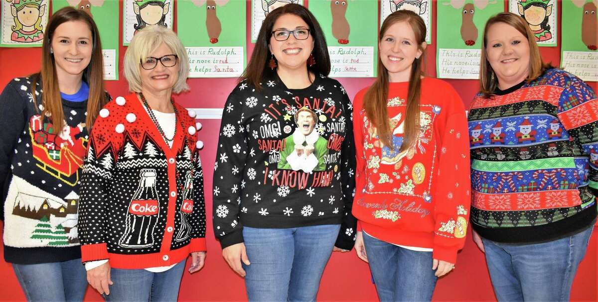 Teachers at Needville Elementary competed to see who could claim the title of Ugliest Christmas Sweater. In the kindergarten pod, the unofficial winner was paraprofessional Monica Houston with her likeness of Will Ferrell in the title role of the movie