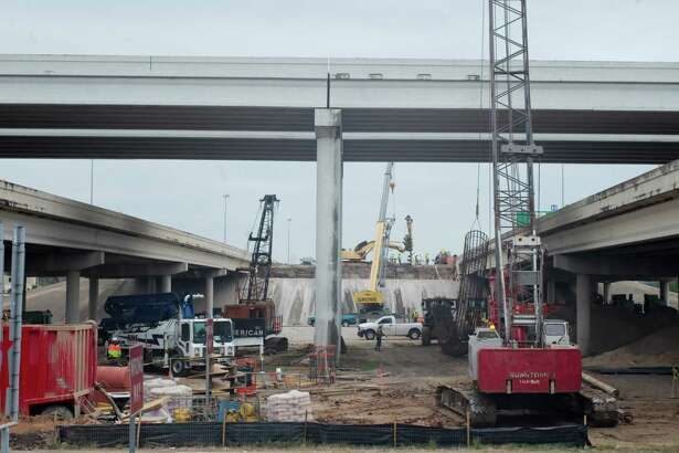 Heavy equipment and utility vehicles line Texas 288 at Beltway 8 in 2016 during construction of toll lanes and related ramps. The company building the Harris County portion of the project projects the lanes will open this summer.