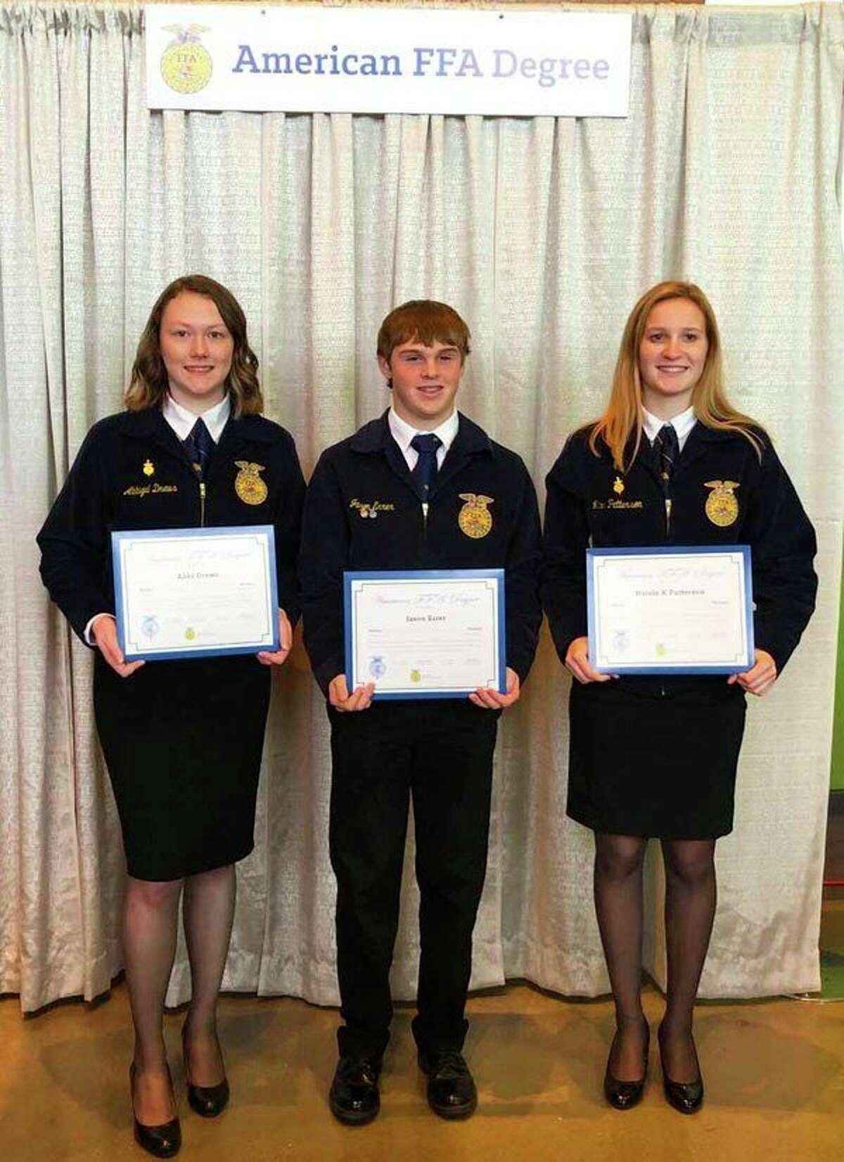 Abbi Drews, Jason Errer and Nicole Patterson hold their FFA American Degrees; absent is Tyler Gilbert. (Sara Eisinger/ Huron Daily Tribune)