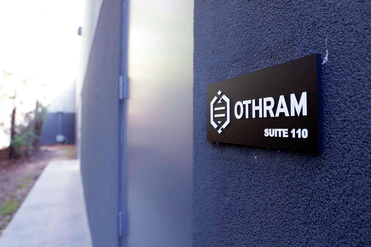 Small sign on a non-descript building tucked away behind layers of trees at Othram Inc, a forensic DNA sequencing laboratory Friday, Nov. 15, 2019 in The Woodlands, TX.