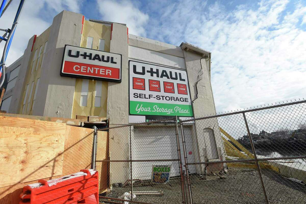 """The U-Haul moving and storage facility at 25 Jefferson Street in Stamford, Conn., shown in a photograph taken on Dec. 11, 2019 was closed Oct. 24 by the city and the company due to concerns about the west wall and the structure after work on the seawall. U-Haul has said that the building, which dates back to 1912, has been vacated """"while construction demands are being addressed."""""""
