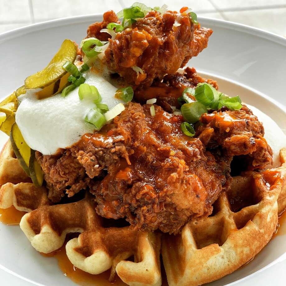 Gather hustles and bustles during brunch hours as the restaurant dishes out plates like the chicken and waffles. Photo: Gather Kitchen And Bar