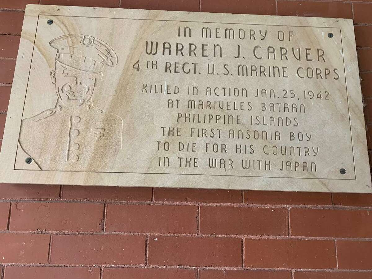 Warren Carver the first Ansonia resident killed during World War II's battles in the Pacific has a sign in his honor on the stairway walls leading into City Hall.