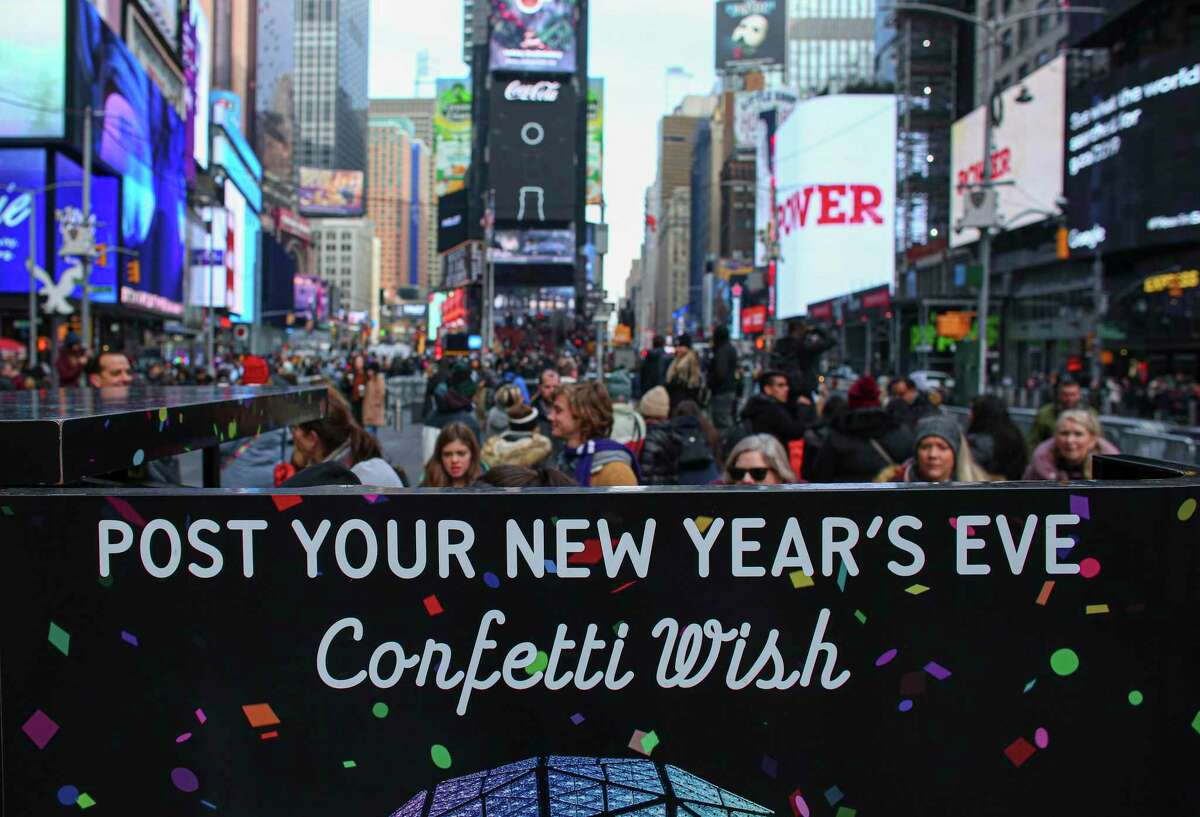 People visit the Wishing Wall station in Times Square in New York City on Dec. 26, 2019. These notes with wishes are added to over a ton of confetti that floats down at midnight onto the revelers gathered in Times Square in celebration of the new year.